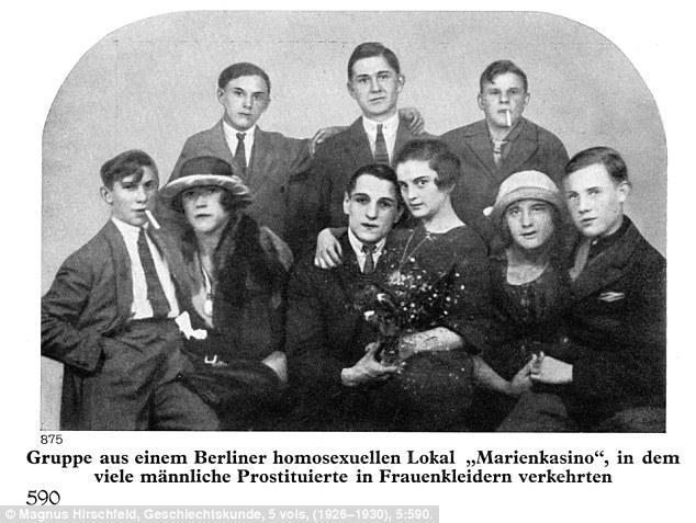 Transvestites sitting_on_the_laps_of_gay_men